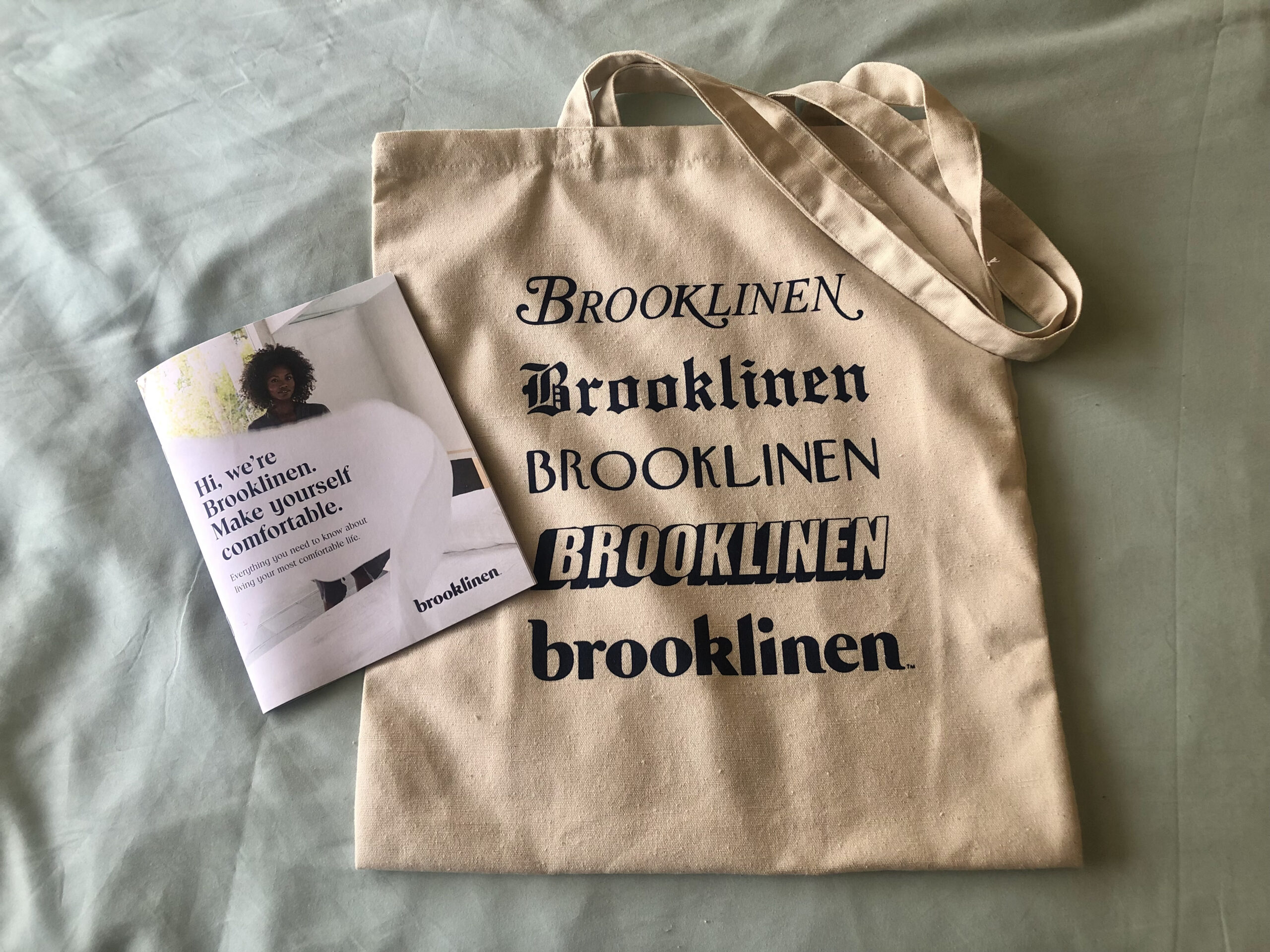 """A tote bag with the words """"brooklinen"""" stamped on the front in different font styles"""