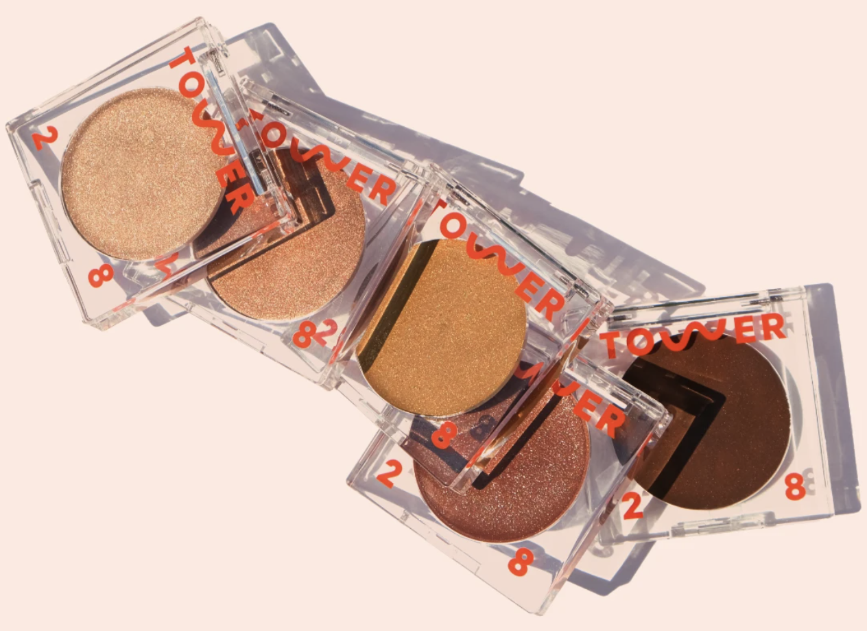 A handful of Tower 28 Beauty bronzers are shown in different shades