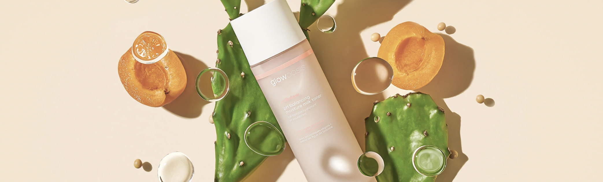 glowoasis face toner is seen with cactus leaves and papaya