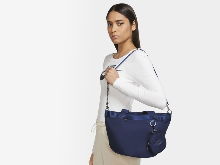 woman with nike shirt and bag